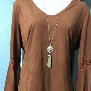 Gorgeous rust color suede top with belle sleeves